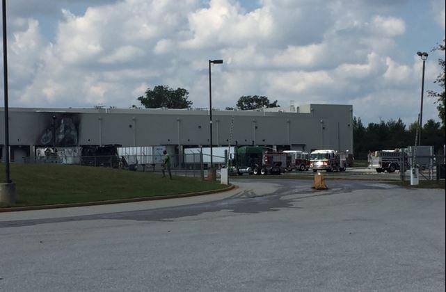 Scorched trailers and wall at Gordon Food Service (FOX Carolina)