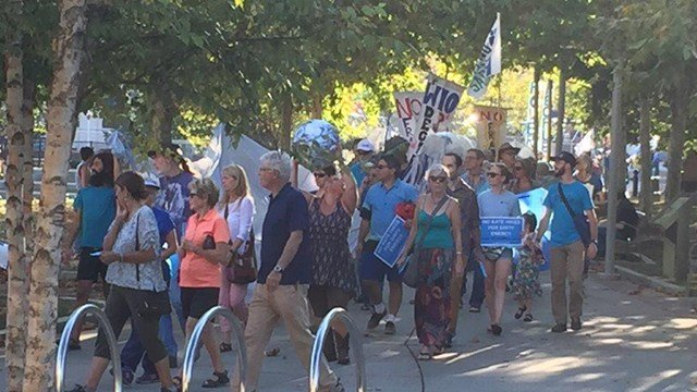 People gathered in Asheville to protest a proposed increase in Duke Energy rates. (FOX Carolina/ 9/27/17)