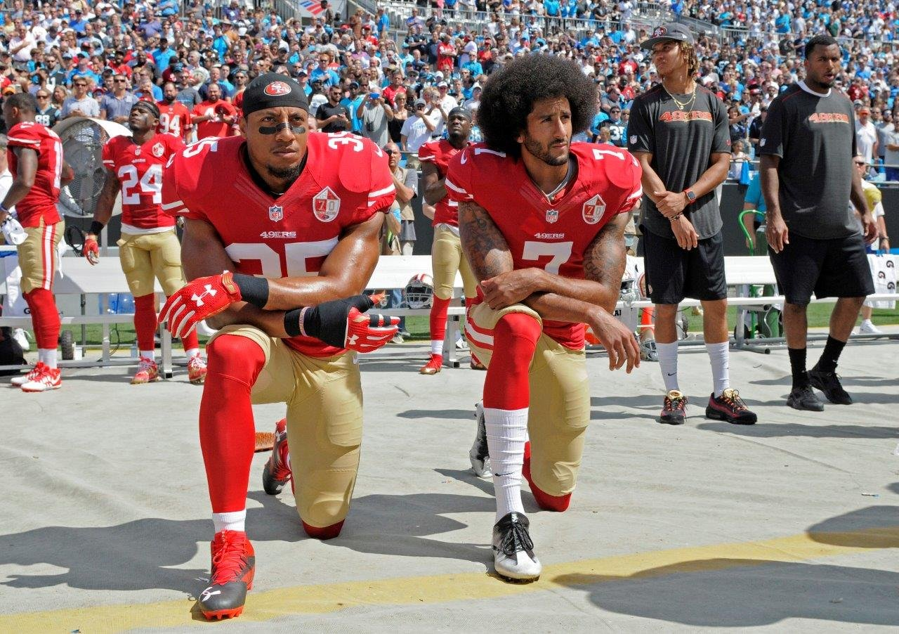 San Francisco 49ers' Colin Kaepernick (7) and Eric Reid (35) kneel during the national anthem before an NFL football game, Sept. 18, 2016. (AP Photo/Mike McCarn)