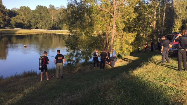 Dive team working to recover car from pond. (10/2/17 FOX Carolina)
