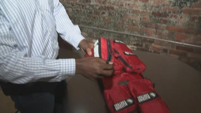 Gregory Tony, President of Blue Spear Solutions examines safety kit. (FOX Carolina/ October 2, 2017)