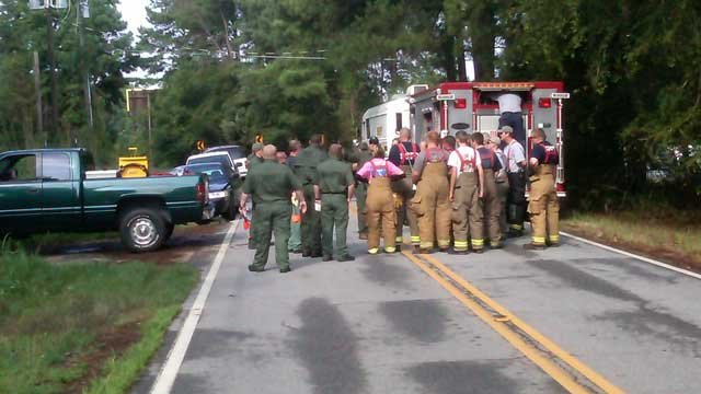 Crews meet before beginning their search of property surrounding an Anderson County well. (July 14, 2011/Anderson Co. Sheriff's Office)