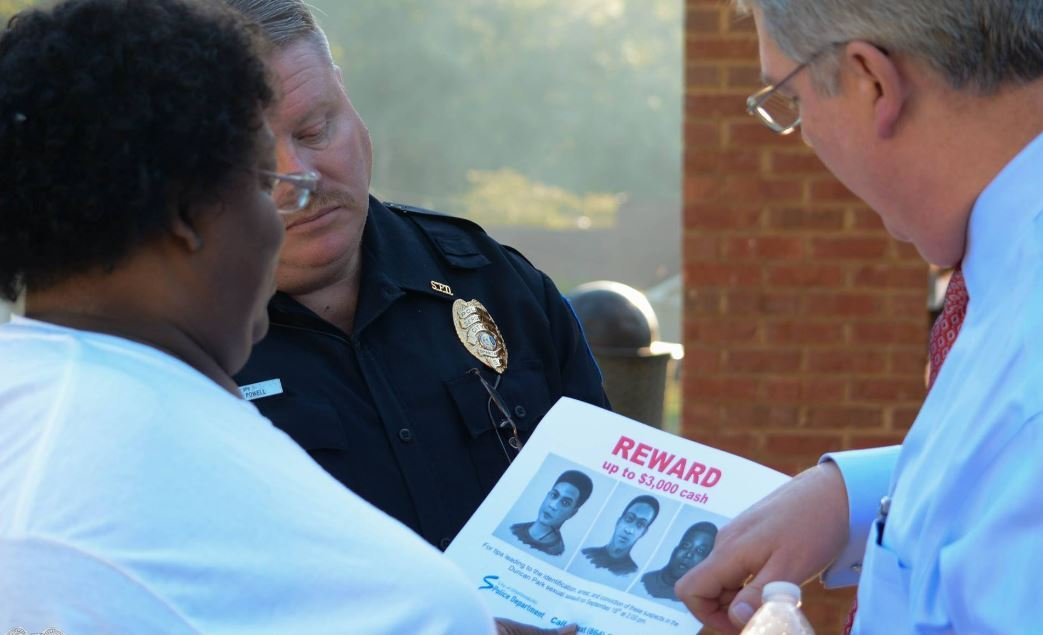 Police hand out flyers in investigation (Source: Spartanburg PD)