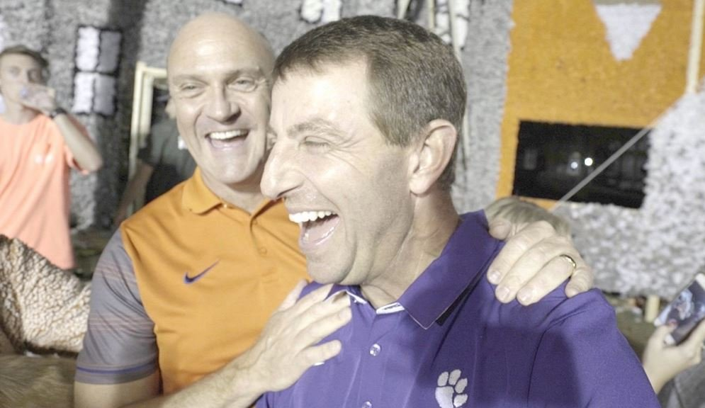 Clemson President Jim Clements (left) and head football coach Dabo Swinney scope out the Tigerama floats. (Source: Jim Clements)