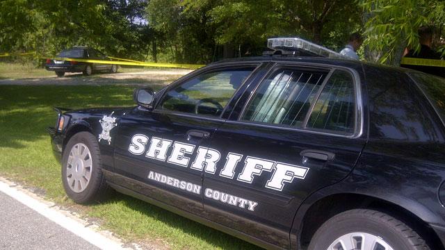 Investigators comb the scene where a man was found shot to death. (July 18, 2011/FOX Carolina)