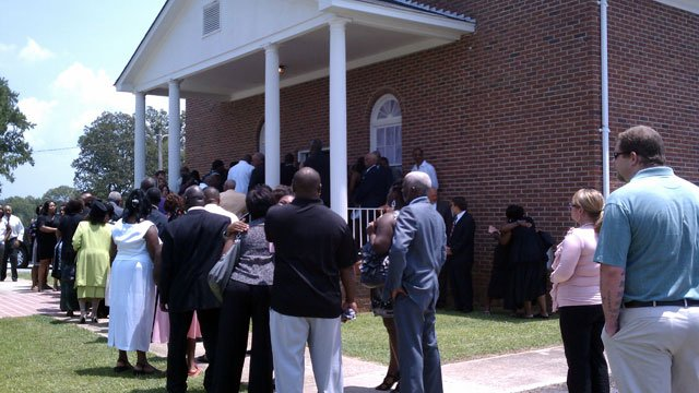 Mourners gather at a Clinton church for the funeral of Nicole Kingsborough. (July 19, 2011/FOX Carolina)