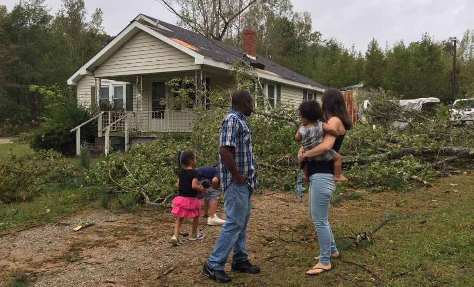 The Sanders family surveys the damage outside their home (FOX Carolina/ Oct. 9, 2017)
