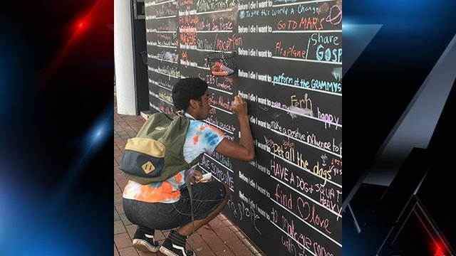 Before I Die Wall project  installed on W. Main Street in Spartanburg. (FOX Carolina/10/11/17)