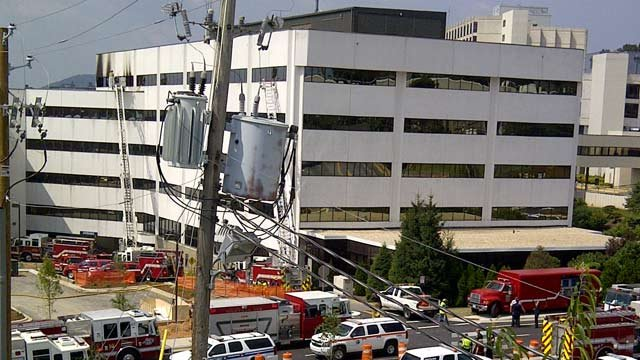 A fire truck's ladder is extended to a window on the fifth floor of an Asheville building. (July 28, 2011/FOX Carolina)
