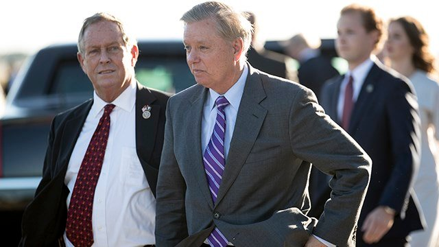 3.	Rep. Joe Wilson, R-S.C., left and Sen. Lindsey Graham, R-S.C., arrive with President Donald Trump arrives on Air Force One at GSP (Source: Associated Press)