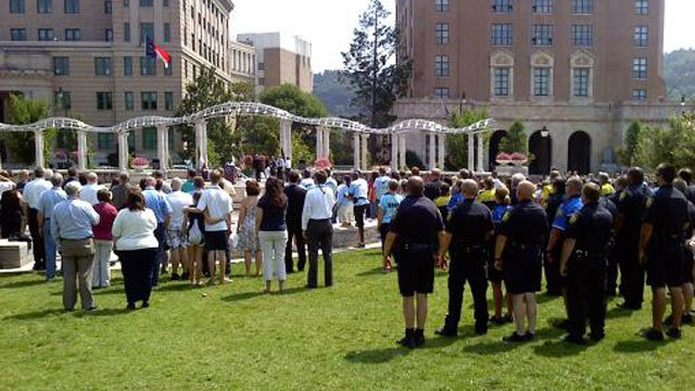People gather at Pack Square for a moment of silence in Bowen's honor. (July 29, 2011/FOX Carolina)