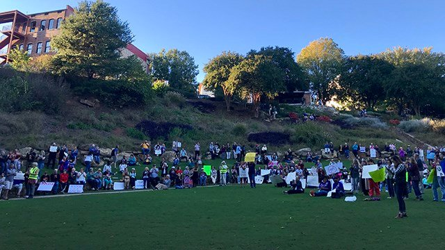 People gathered in Falls Park to protest President Trump. (October 16, 2017/FOX Carolina)