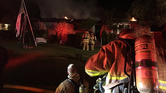 Fire fighters respond to house fire in Greenville