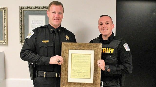 Deputy Elgin (r) with Sheriff McBride (l). (Source: ACSO)