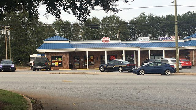Scene of search for armed robbery suspect in Easley. (10/12/17 FOX Carolina)