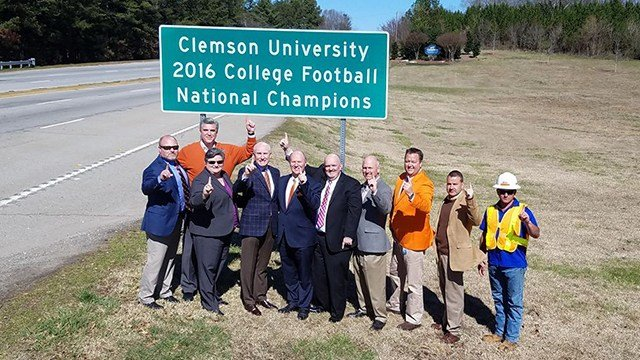 Upstate leaders posed with Highway 76 Clemson sign in March 2017 (Source: SCDOT)
