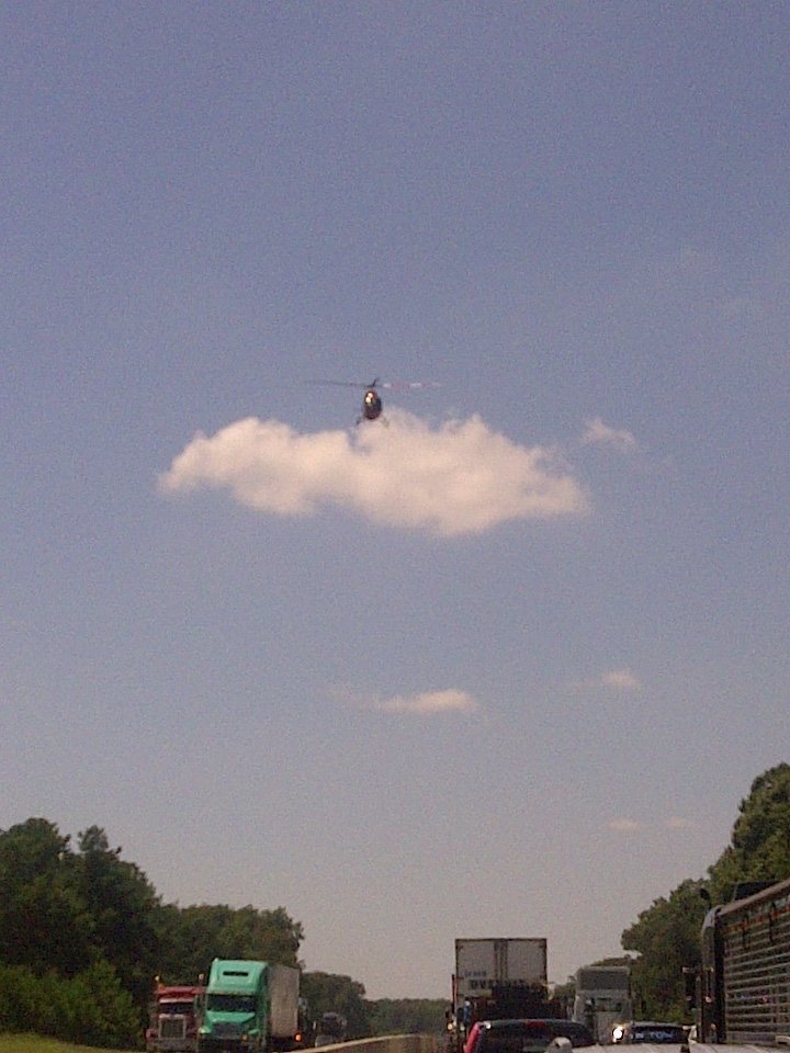A medical helicopter flies away from the scene of an accident on I-85