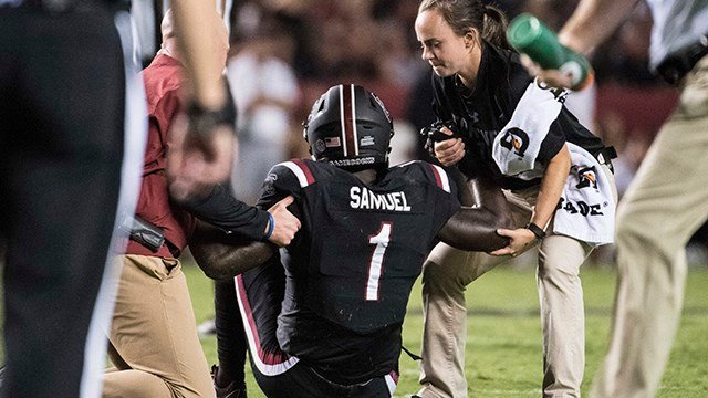 Deebo Samuel is helped by trainers after an injury during the second half of an NCAA college football game against Kentucky. (Source: AP Images)
