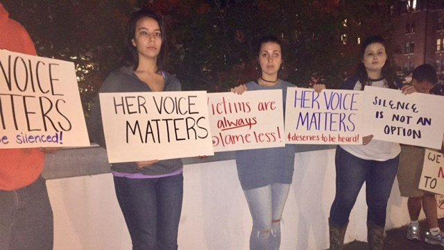 Protest signs being held outside of Clemson University. (11/6/17 FOX Carolina)