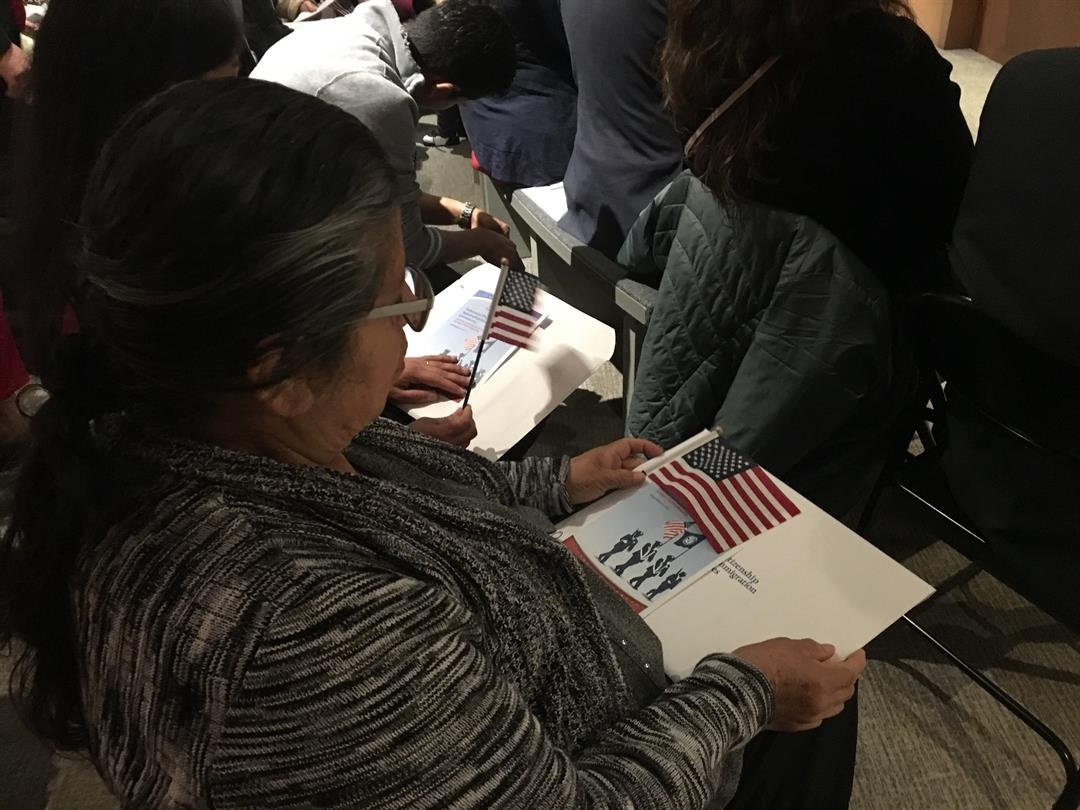 Naturalization ceremony for 18 new U.S. citizens (FOX Carolina: 11/9/17).