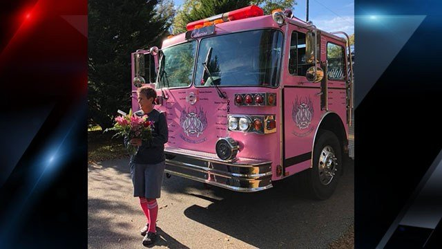 Asst. Chief Kim Strickland poses in front of the pink fire truck (Source: Broadway FD)