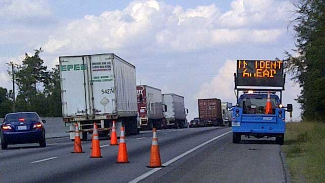 An SCDOT truck blocks off lanes of I-85 while deputies investigate a truck. (FOX Carolina)