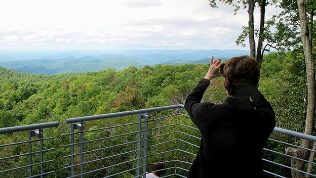 A visitor takes a photograph from the top of Sassafras Mountain, the highest peak in South Carolina, on Sept. 27, 2014.  (Credit: AP Images)
