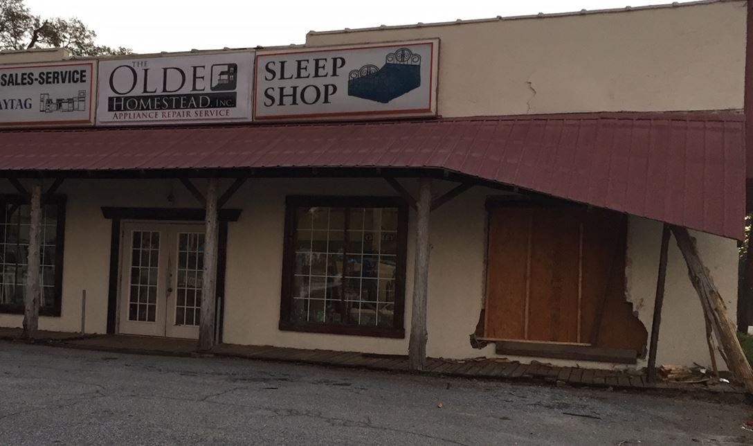 Storefront where the suspect's vehicle crashed when the chase ended (FOX Carolina/ Nov. 20, 2017)