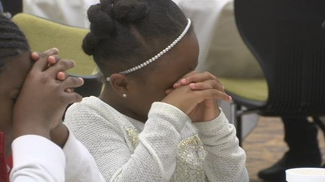 Greenville Boys and Girls Club members praying before the Thanksgiving feast on Monday. (11/20/17 FOX Carolina)