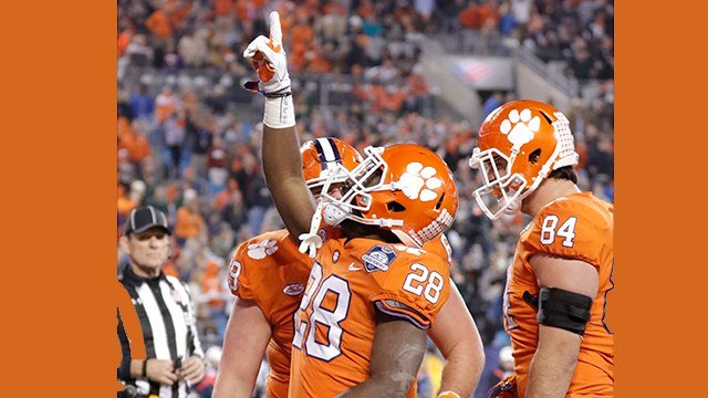 Clemson's Tavien Feaster (28) celebrates his touchdown against Miami during the second half of the ACC championship. (Source: AP Images)