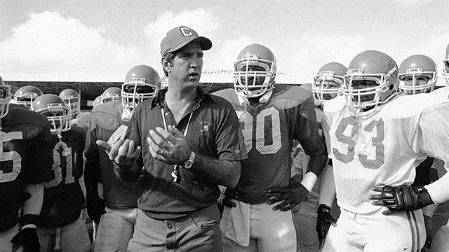 Clemson head Coach Danny Ford gives a few pointers to members of the Clemson football team on Dec. 26, 1981 as the players compete in the Orange Bowl game against the University of Nebraska. (Source: AP Images)