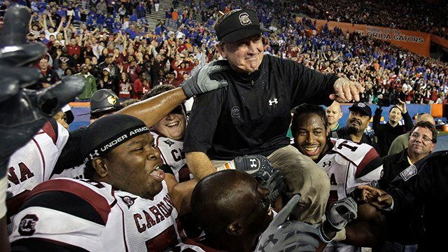 South Carolina head coach Steve Spurrier is carried onto the field by his players after defeating Florida 36-14 in an NCAA college football game in Gainesville, Fla., Saturday, Nov. 13, 2010. (Source: AP Images)