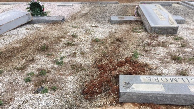 Damaged headstones at cemetery (Dec. 6, 2017/FOX Carolina)