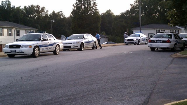 Police cars are parked along streets of an apartment complex after a shooting. (Sept. 28, 2011/FOX Carolina)