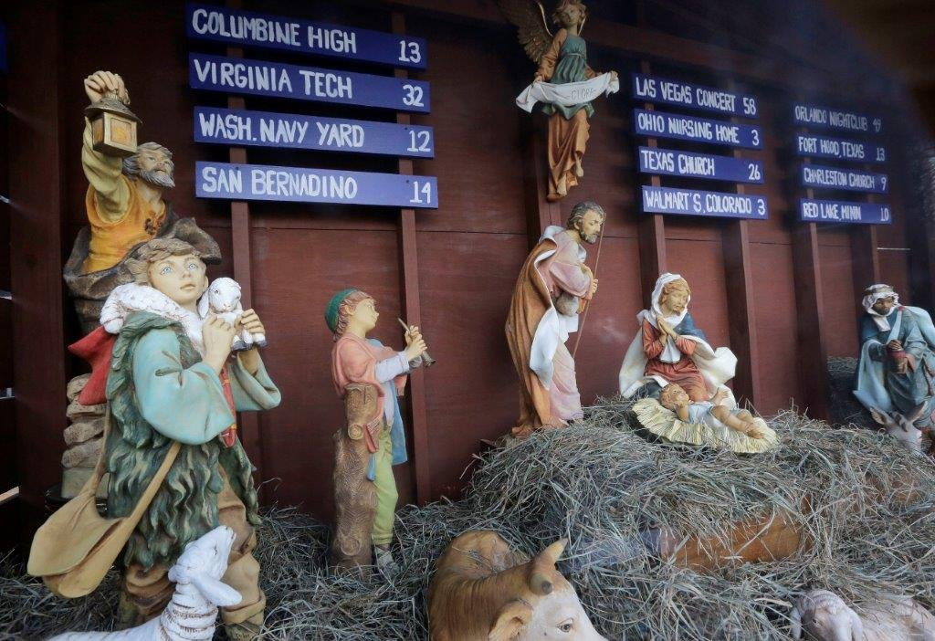 The Catholic church is using its Nativity scene to call attention to gun violence. (AP Photo/Steven Senne)