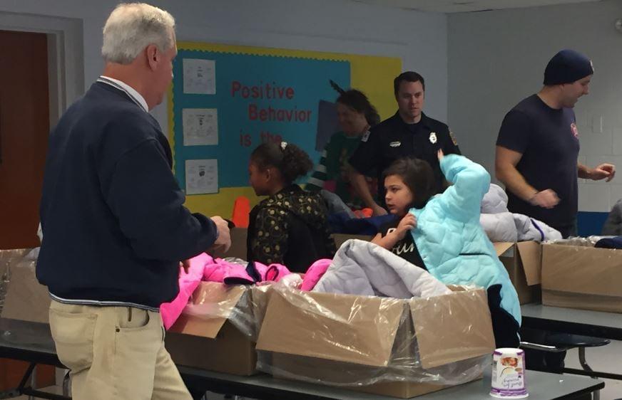 Firefighters distribute coats (FOX Carolina/ December 18, 2017)