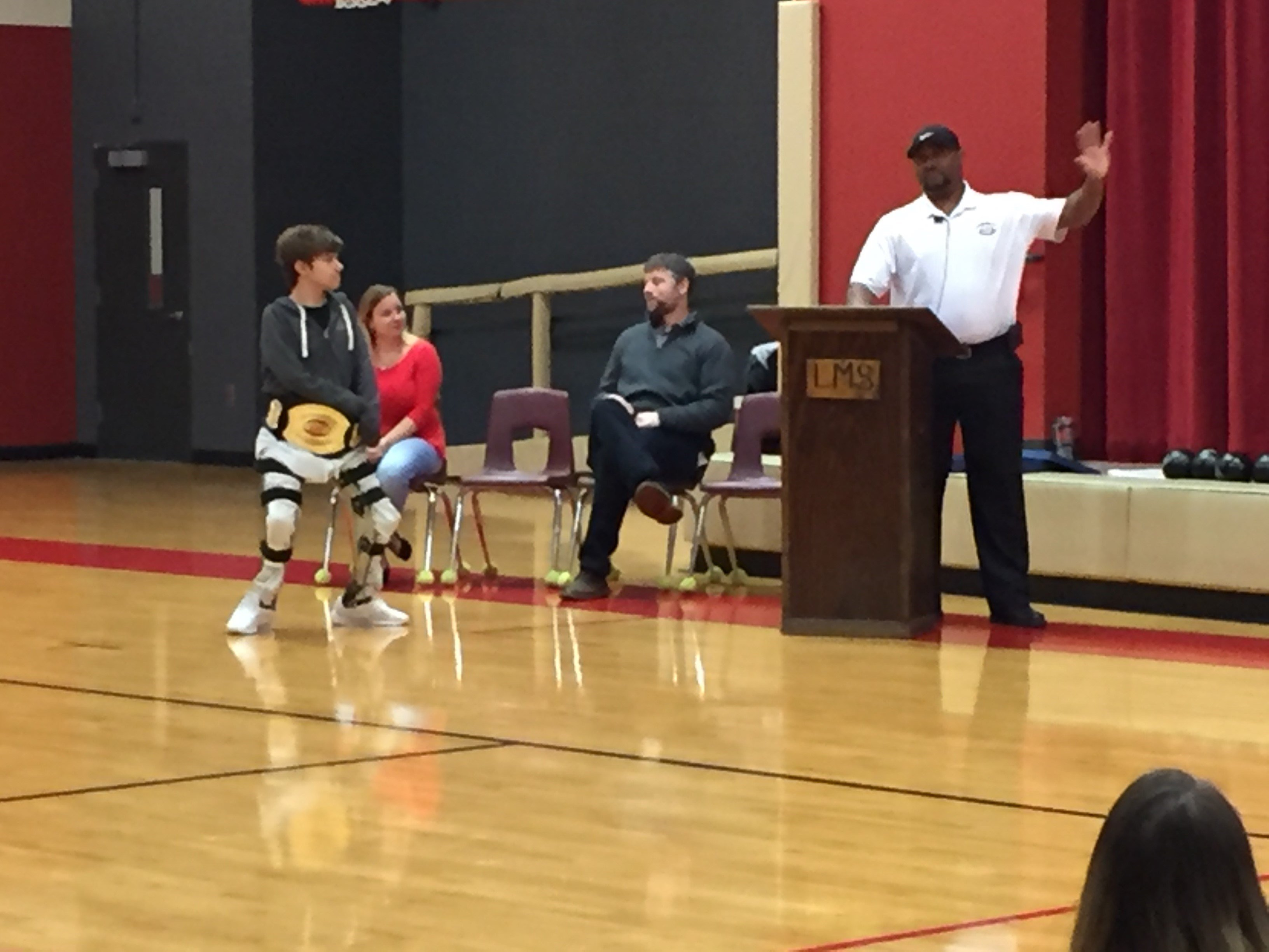 Izzy is presented with the 'Heart of a Champion' award (FOX Carolina/ Dec. 19, 2017)