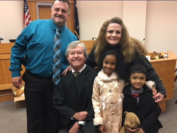 Judge Long poses for a photo with a new forever family (Dec. 20, 2017/ FOX Carolina)
