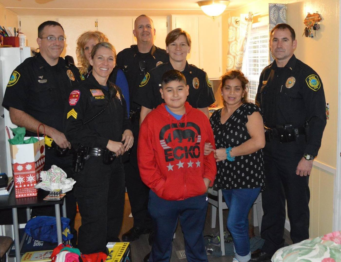 Asheville officers with the Flores family (Source: APD)