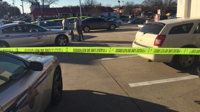 Suspect vehicle taped off at Woodruff Road and Highway 14 (Dec. 28, 2017/FOX Carolina)