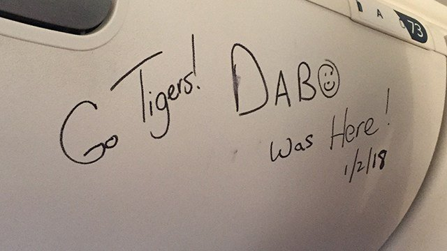 Dabo Swinney signs Boeing 747 overhead compartment (Jan. 2, 2018/FOX Carolina)
