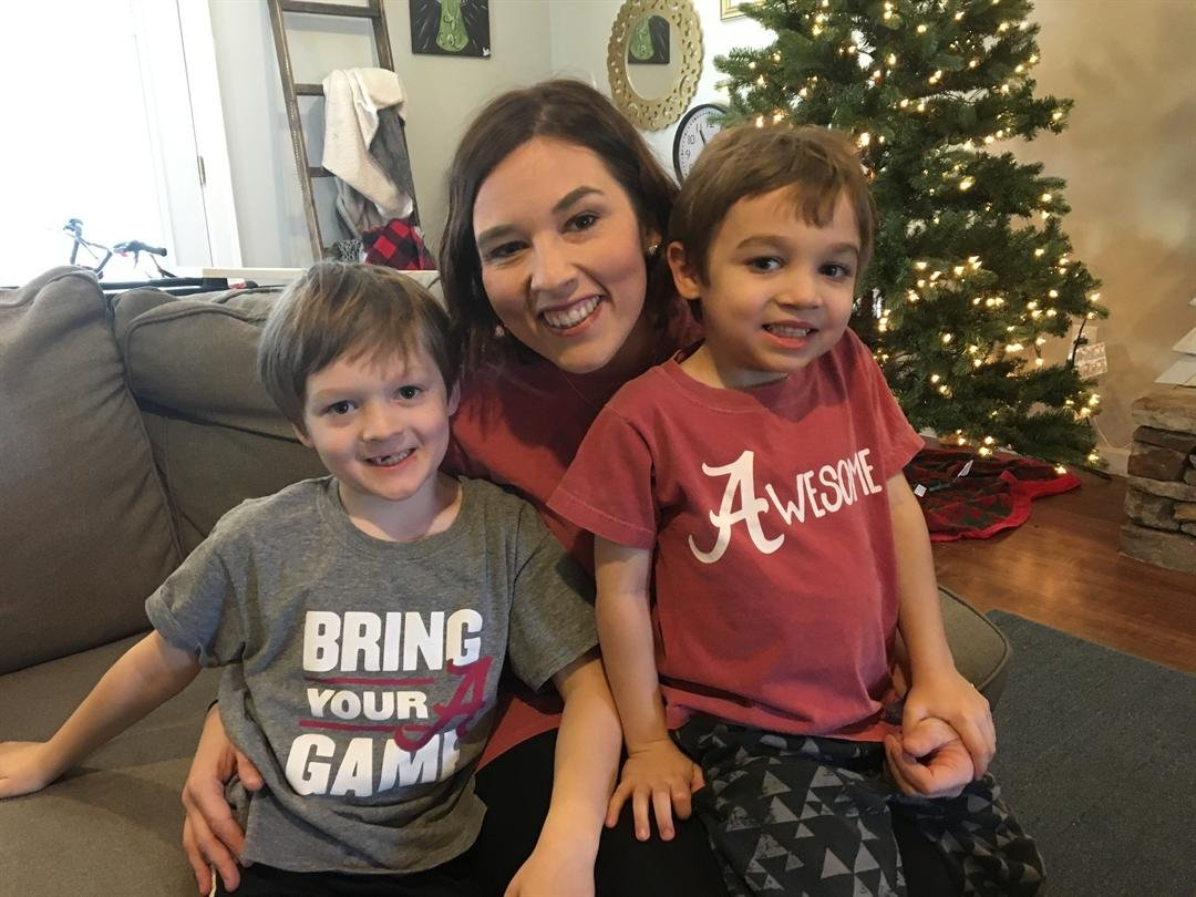 Alabama fan, Kassi Owens, shows off her pride with sons Parker (left) and Reed (right) (FOX Carolina: 1/4/2018).
