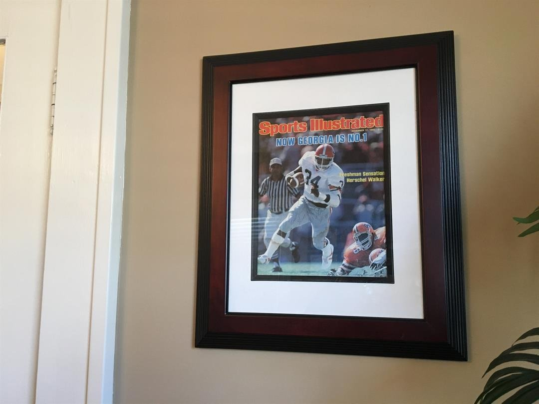 Sims keeps a personalized picture, autographed by Herschel Walker, in his Greer office (FOX Carolina: 1/4/2018).