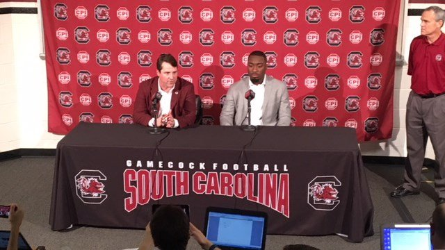 Coach Will Muschamp (L) speaking to media alongside Marcus Lattimore (R). (1/12/18 FOX Carolina)