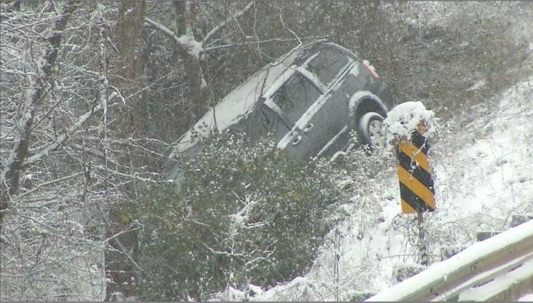 Photo of car down embankment (Jan. 17, 2018/ FOX Carolina)