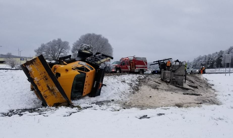 Snow plow overturns (Source: Lucas McDaniel)