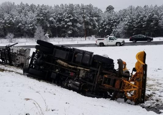 Snow plow overturns (Source: Lucas McDaniel)