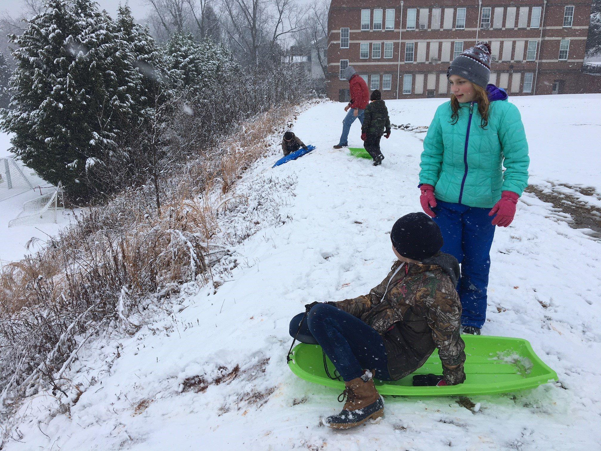 Union County children sled down hill behind YMCA (FOX Carolina: 1/17/18).