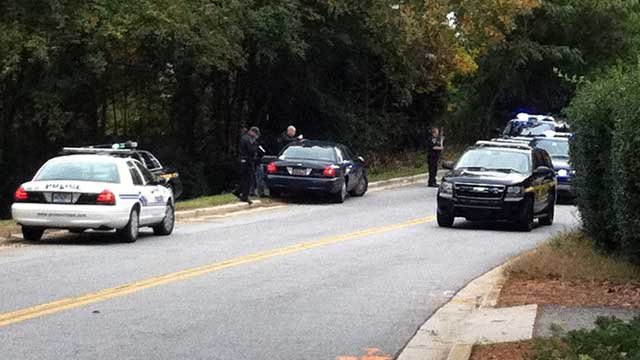 Police have assault rifles with them as the conduct a search for a man who they say fired shots at an officer. (Oct. 28, 2011/FOX Carolina)