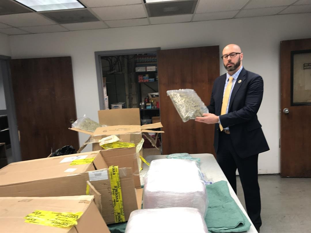 Lt. Ross Brown holds evidence collected during 2017